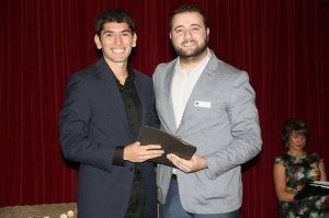 Tarik Misho presents the St. James Knights of Columbus scholarship for character to Nic Villarreal at the Holy Trinity Academy Scholarship and Awards Evening on Oct. 8. Don Patterson/OWW